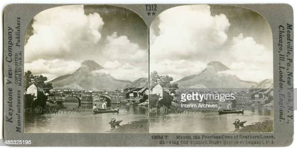 Stereoscopic view of Mayon volcano renowned for its near perfect cone shape Philippines 1906 The old Spanish stone bridge in Legaspi s visible in the...