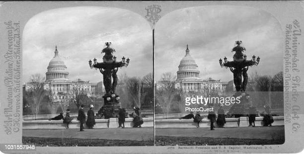 Stereoscopic view of onlookers at the Bartholdi Fountain, and the US Capitol behind it, on Capitol Hill, Washington DC, 1901. The fountain was later...