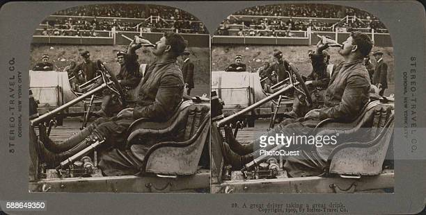 Stereoscopic view of Swiss race car driver Louis Chevrolet as he drinks a bottle of Coca-Cola in his 'open-cockpit' automobile at the Atlanta...