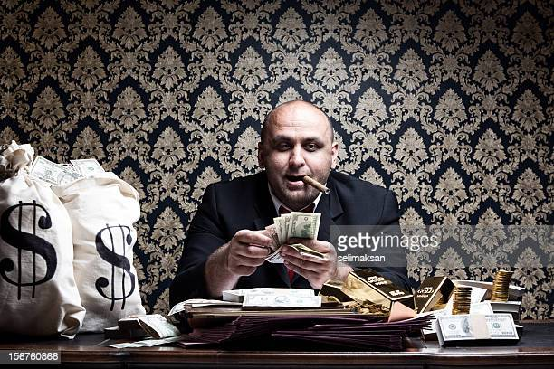 Stereotype Rich Man Posing With Money Bags,Counting Dollar Bills
