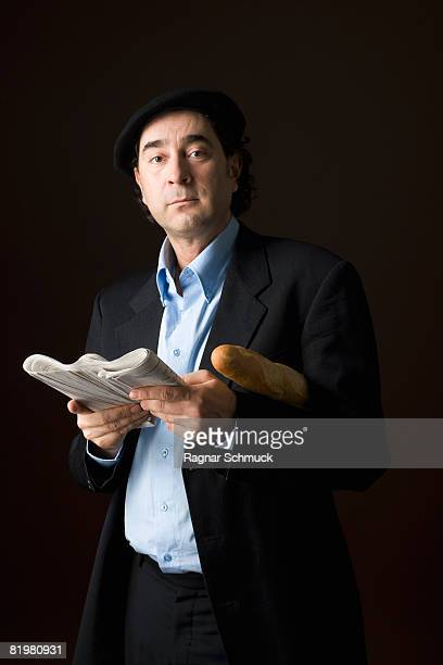 Stereotypical French man with a newspaper and baguette