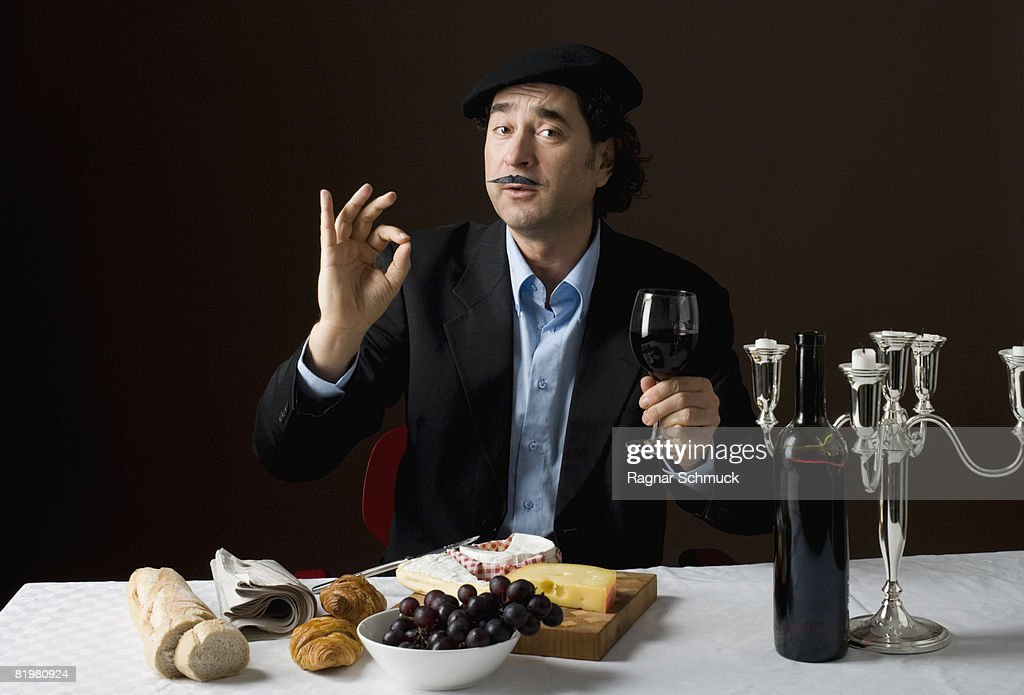 Stereotypical French man with stereotypical French food : Stock Photo