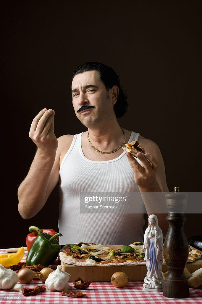 Stereotypical Italian Man Eating pizza and gesturing with hand : Foto de stock