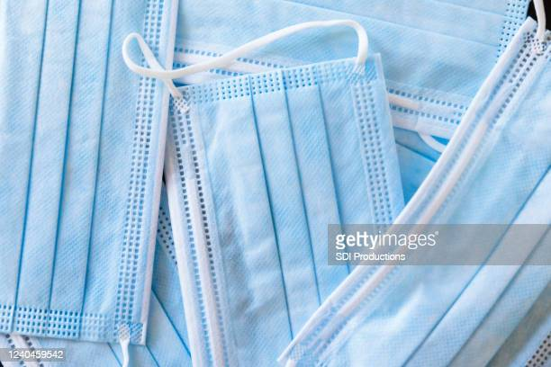 sterile, protective face masks for protection from coronavirus - single use stock pictures, royalty-free photos & images