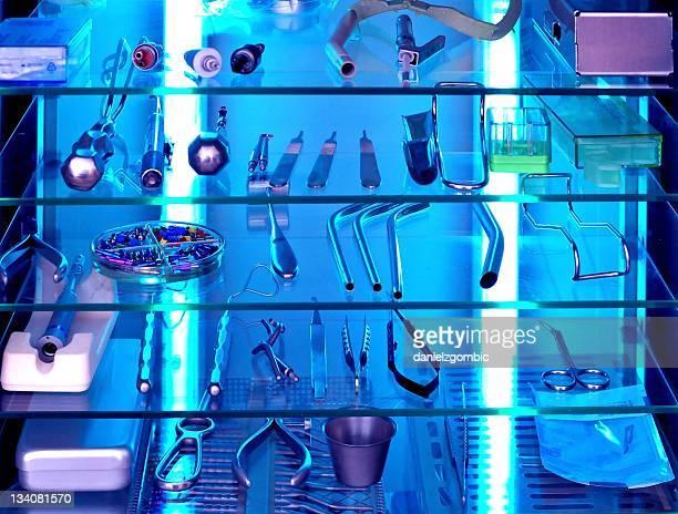 Sterilized dental tools on black lighted shelf