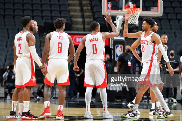 Sterling Brown and Christian Wood of the Houston Rockets hi-five during the game against the San Antonio Spurs on January 14, 2021 at the AT&T Center...