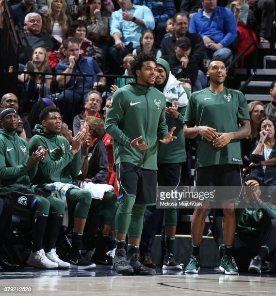 Sterling Brown and Joel Bolomboy of the Milwaukee Bucks react to a play against the Utah Jazz on November 25 2017 at vivintSmartHome Arena in Salt...