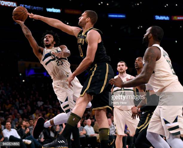 Sterling Brown of the Milwaukee Bucks attempts a shot in front of Brook Lopez of the Los Angeles Lakers during the first half at Staples Center on...