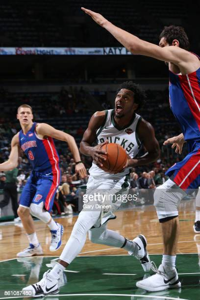 Sterling Brown of the Milwaukee Bucks drives to the basket against the Detroit Pistons on October 13 2017 at the BMO Harris Bradley Center in...