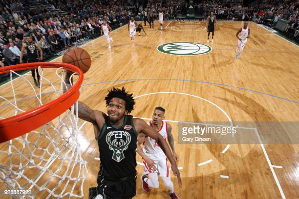Sterling Brown of the Milwaukee Bucks dunks against Gerald Green of the Houston Rockets during the NBA game on March 7 2018 at the BMO Harris Bradley...