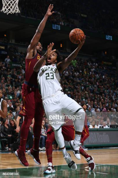 Sterling Brown of the Milwaukee Bucks goes to the basket against the Cleveland Cavaliers on October 20 2017 at the BMO Harris Bradley Center in...