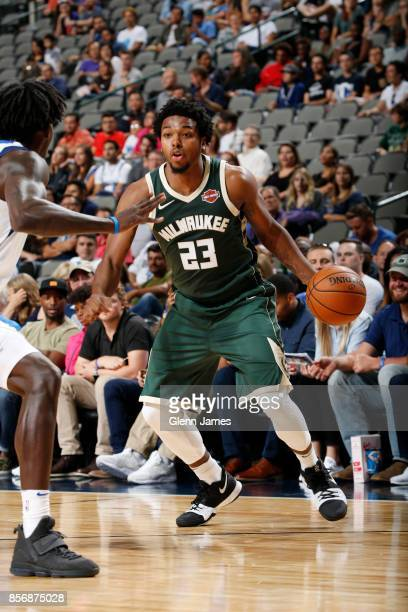 Sterling Brown of the Milwaukee Bucks handles the ball against the Dallas Mavericks during the preseason game on October 2 2017 at the American...