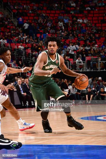 Sterling Brown of the Milwaukee Bucks handles the ball against the Detroit Pistons on February 28 2018 at Little Caesars Arena in Detroit Michigan...