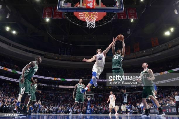 Sterling Brown of the Milwaukee Bucks rebounds the ball during the game against the Philadelphia 76ers on April 11 2018 in Philadelphia Pennsylvania...