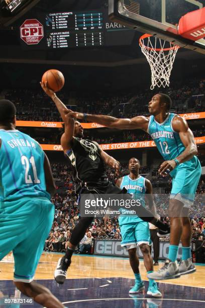 Sterling Brown of the Milwaukee Bucks shoots the ball against the Charlotte Hornets on December 23 2017 at the Spectrum Center in Charlotte North...