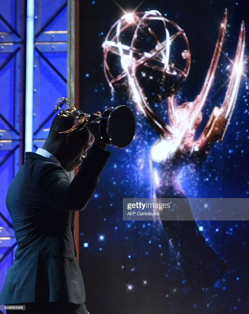 Sterling K. Brown accepts the award for Outstanding Lead Actor in a Drama Series for 'This is Us' onstage during the 69th Emmy Awards at the Microsoft Theatre on September 17, 2017 in Los Angeles, California. / AFP PHOTO / Frederic J. Brown