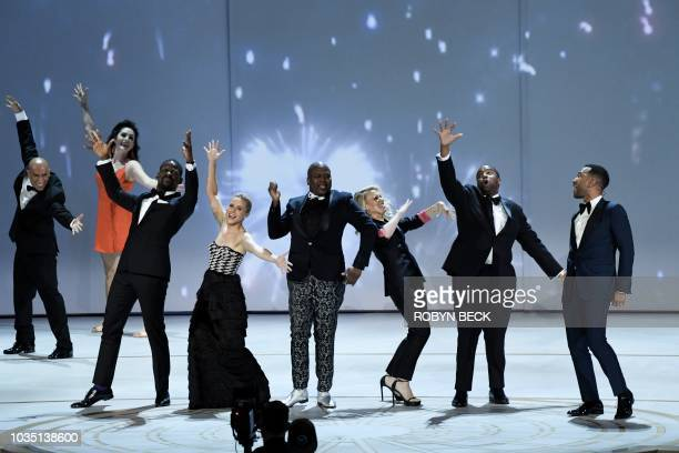 TOPSHOT Sterling K Brown Kristen Bell Tituss Burgess Kate McKinnon Kenan Thompson RuPaul and John Legend onstage during the 70th Emmy Awards at the...