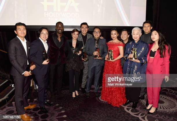 Sterling K. Brown poses with Ronny Chieng, Jimmy O. Yang, Michelle Yeoh, Henry Golding, Nico Santos, Constance Wu, Ken Jeong, Lisa Lu, Harry Shum...