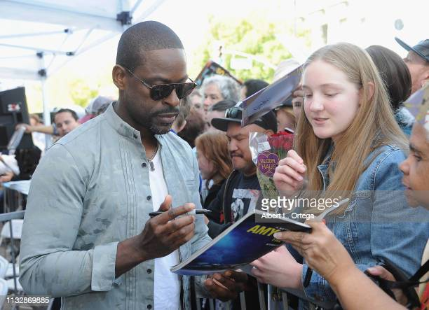 Sterling K Brown signs autographs at Mandy Moore's Star Ceremony on the Hollywood Walk of Fame on March 25 2019 in Hollywood California