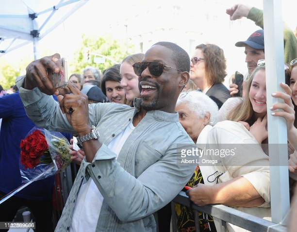 Sterling K Brown takes selfies with fans at Mandy Moore's Star Ceremony on the Hollywood Walk of Fame on March 25 2019 in Hollywood California