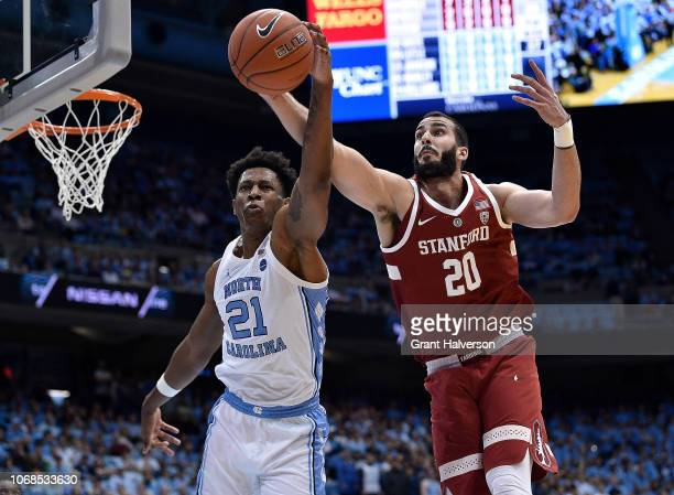 Sterling Manley of the North Carolina Tar Heels battles Josh Sharma of the Stanford Cardinal for a rebound during their game at the Dean Smith Center...