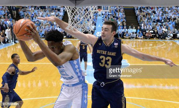 Sterling Manley of the North Carolina Tar Heels takes a rebound away from John Mooney of the Notre Dame Fighting Irish during their game at the Dean...