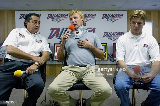 Sterling Marlin driver of the Ganassi Racing Dodge Intrepid R/T talks with the media alongside team owner Felix Sabates and replacement driver Jamie...