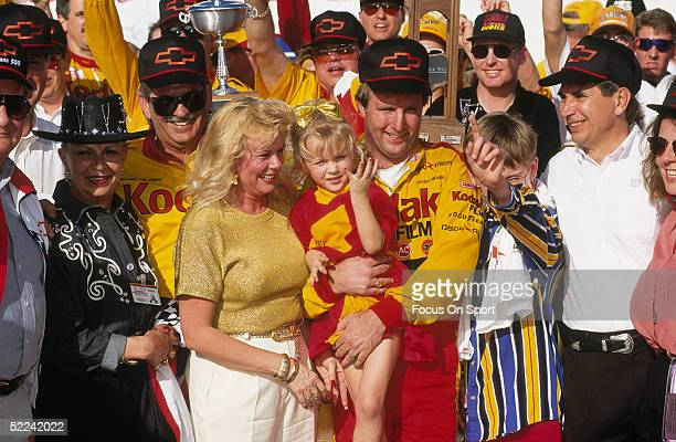 Sterling Marlin holds up his kid and stands next to his wife Paula after winning the Daytona 500 at the Daytona Speedway on February 20 1994 in...