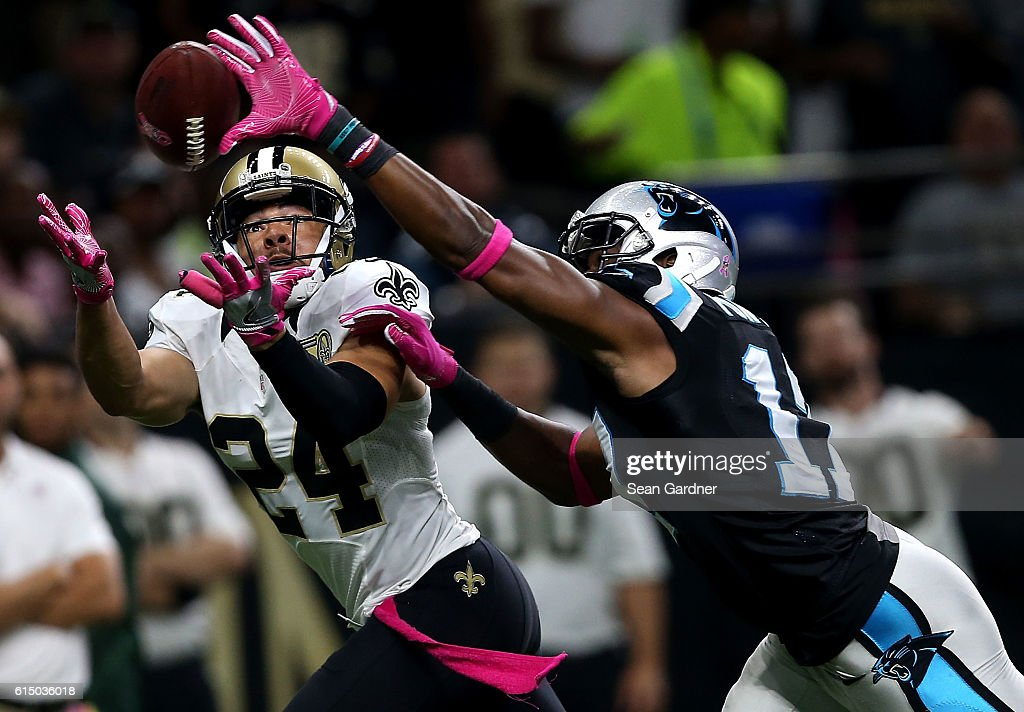 Sterling Moore #24 of the New Orleans Saints intercepts a pass over Devin Funchess #17 of the Carolina Panthers during the second quarter at the Mercedes-Benz Superdome on October 16, 2016 in New Orleans, Louisiana.