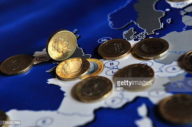 A Sterling pound coin is pictured nexto to an Euro coins collection on December 9 2011 in Milan AFP PHOTO / GIUSEPPE CACACE
