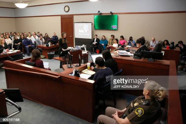 Sterling Riethman reads her statement as Former Michigan State University and USA Gymnastics doctor Larry Nassar listens to impact statements during...