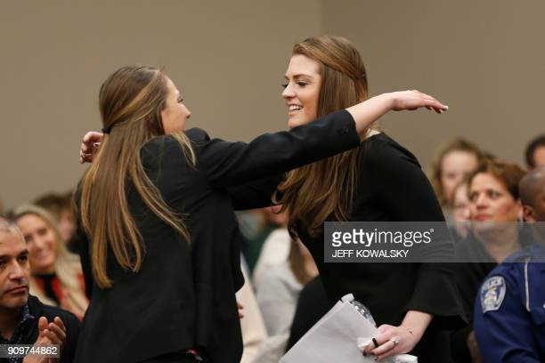 Sterling Riethman receives a hug from Kyle Stephens as former Michigan State University and USA Gymnastics doctor Larry Nassar listens to impact...