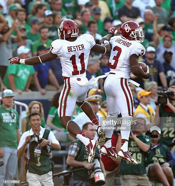 Sterling Shepard Irish of the Oklahoma Sooners celebrates his touchdown run with Lacoltan Bester against the Notre Dame Fighting Irish at Notre Dame...
