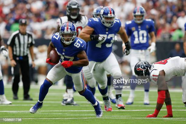 Sterling Shepard of the New York Giants escapes the tackle by Zach Cunningham of the Houston Texans in the first half at NRG Stadium on September 23...