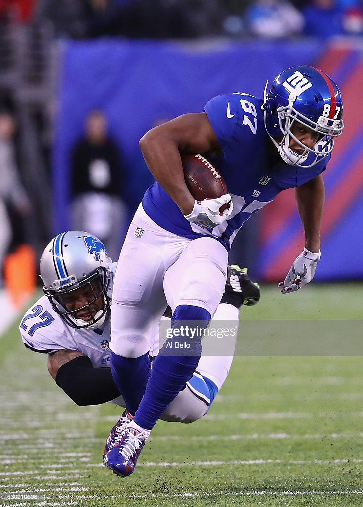 Sterling Shepard #87 of the New York Giants evades a tackle by Glover Quin #27 of the Detroit Lions in the second half at MetLife Stadium on December 18, 2016 in East Rutherford, New Jersey.