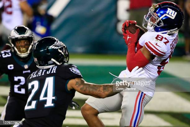 Sterling Shepard of the New York Giants hauls in a touchdown reception against Darius Slay and Rodney McLeod of the Philadelphia Eagles during the...