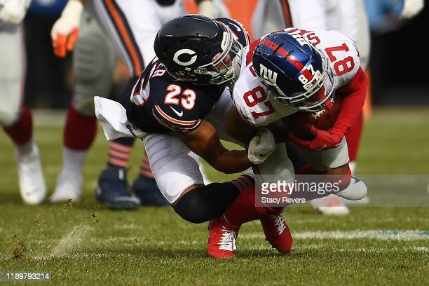 Sterling Shepard of the New York Giants is brought down by Kyle Fuller of the Chicago Bears during the first half at Soldier Field on November 24...