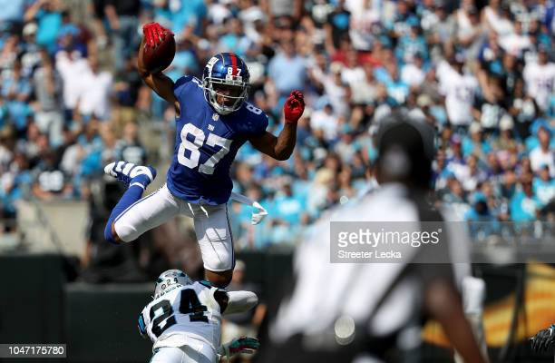 Sterling Shepard of the New York Giants jumps over James Bradberry of the Carolina Panthers in the second quarter during their game at Bank of...