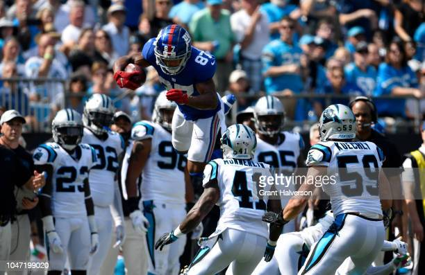 Sterling Shepard of the New York Giants leaps against the Carolina Panthers in the second quarter during their game at Bank of America Stadium on...
