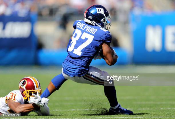 Sterling Shepard of the New York Giants makes the catch as Fabian Moreau of the Washington Redskins defends at MetLife Stadium on September 29, 2019...