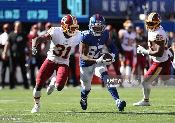 Sterling Shepard of the New York Giants runs after a catch against Fabian Moreau of the Washington Redskins during their game at MetLife Stadium on...