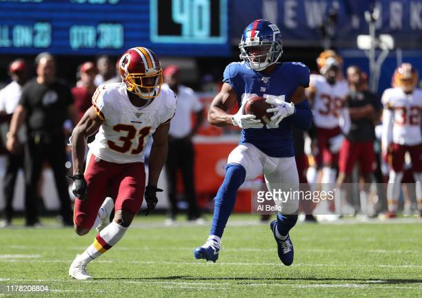 Sterling Shepard of the New York Giants runs against Fabian Moreau of the Washington Redskins during their game at MetLife Stadium on September 29,...