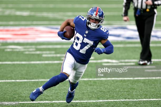 Sterling Shepard of the New York Giants scores on a 23-yard rushing touchdown against the Dallas Cowboys during the first quarter at MetLife Stadium...