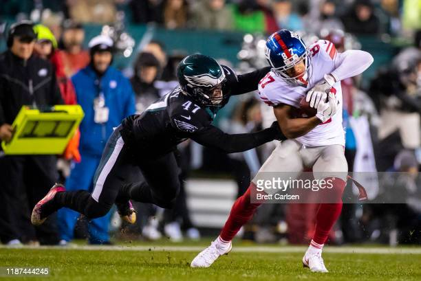 Sterling Shepard of the New York Giants sheds a tackle attempt by Nate Gerry of the Philadelphia Eagles during the first quarter at Lincoln Financial...