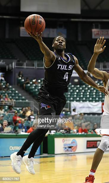 Sterling Taplin of the Tulsa Golden Hurricane slips around the Illinois defense and lays the ball in during the second half of the Diamond Head...
