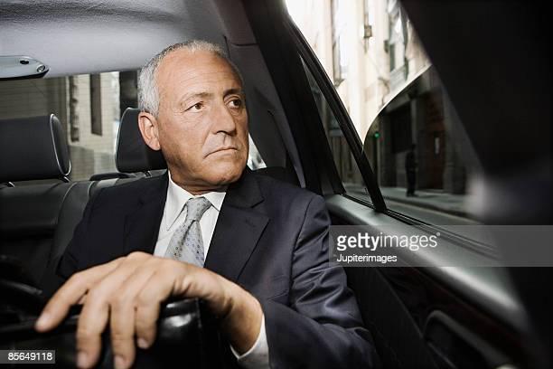 Stern businessman in car