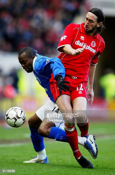 Stern John of Birmingham City shows is tackled by Jonathan Greening of Middlesbrough during the FA Barclaycard Premiership match between...