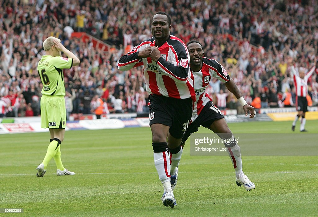 Stern John of Southampton celebrates scoring their second goal with Jason Euell during the Coca-Cola Championship match between Southampton and Sheffield United at St Mary's Stadium on May 4, 2008 in Southampton, England.
