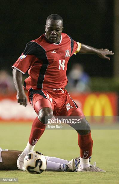 Stern John of Trinidad and Tobago takes the ball away from Asthor Henriquez of Honduras during Round One of the FIFA 2005 CONCACAF Gold Cup at the...