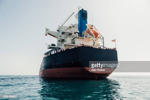 stern (back) of a large cargo ship at sea. - repairing stock pictures, royalty-free photos & images